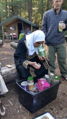 Fatima Obeidat of Kananah Women's Organization, Jordan, experiences T'Sou-ke dried plants. Camp Barnard