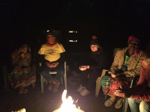 Colombian participants find the Canadian evening cool. Campfire, Camp Barnard