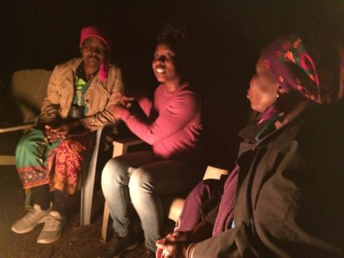 South African participants by the campfire