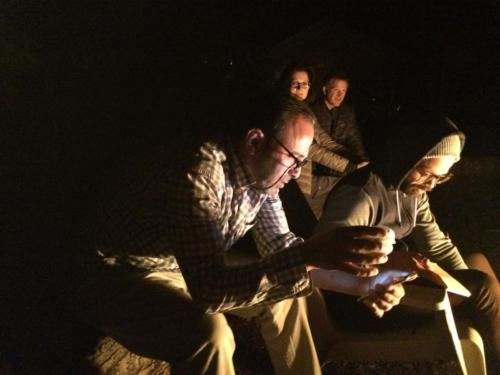 Imad Alquran and Bruno Jayme by the campfire