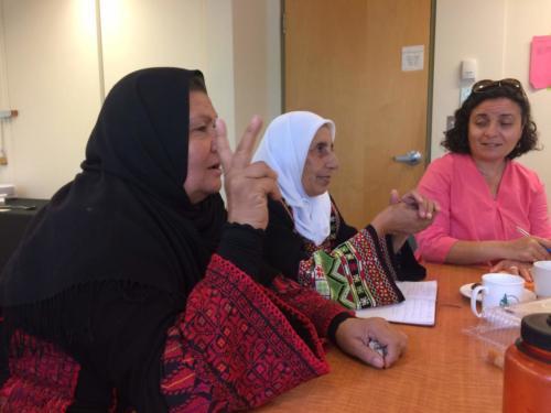 Palestinian miller Aysheh Azzam and Fatima Obeidat of Kananah Women's Organization, Jordan, at the workshop with interpreter Salam Guenette