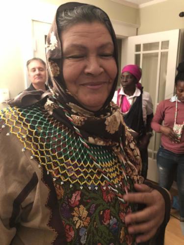 Aysheh Azzam models a necklace beaded by South African women