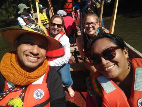 Colombians, Canadians and others enjoy a trip up Sooke River in the T'Sou-ke Nation canoe