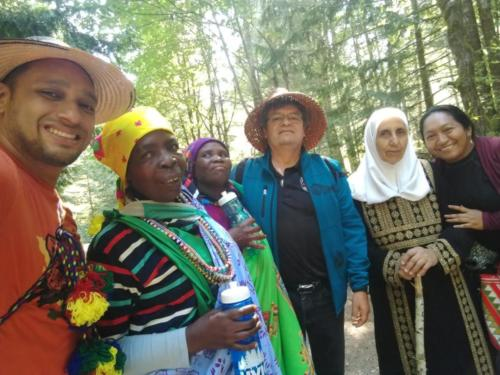 Colombians, South Africans, and Jordanians join Chief Gordon Planes on a hike in T'Sou-ke food-harvesting territory