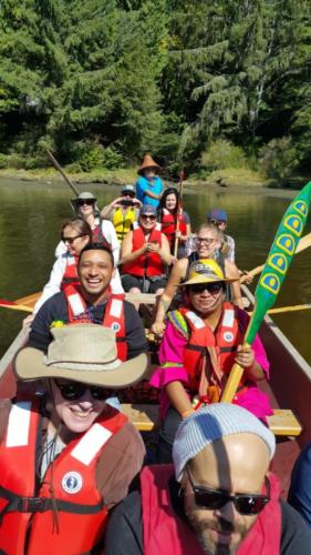 Workshop participants, steered by Chief Gordon Planes, aboard the 54-foot T'Sou-ke Nation canoe