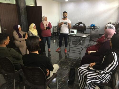 Facilitator Dr. Bruno Jayme and students at the training workshop, Baqa'a Camp