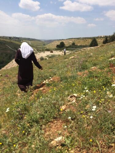 Fatima and her husband in their fields