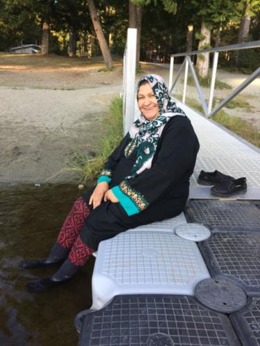 Palestinian miller Aysheh Azzam enjoys the cool lake, Camp Barnard