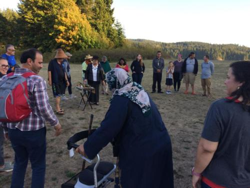Workshop participants join the community circle for a water ceremony and blessing, T'Sou-ke Nation