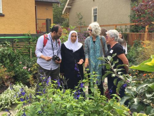 Jordanian workshop participants Imad Alquran and Fatima Obeidat of Jordan with project director Elizabeth Vibert and a home gardener, Victoria Urban Food-Garden Tour