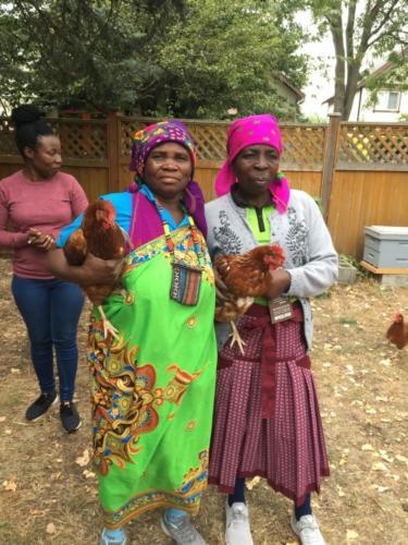 Josephine Mathebula and Mphephu Mtsenga, with Basani Ngobeni, meet the chickens. Victoria Urban Food-Garden Tour